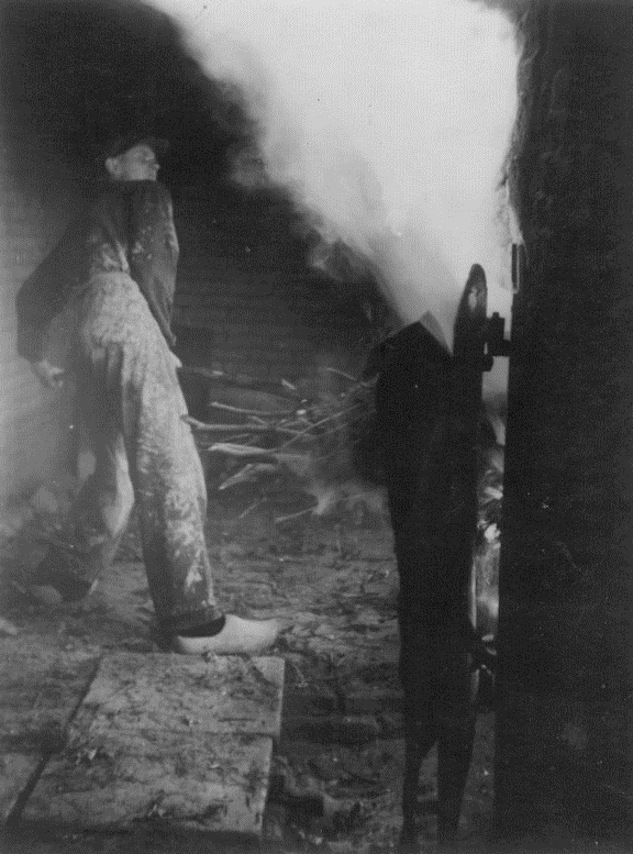 My father firing the wood kiln in Milsbeek
